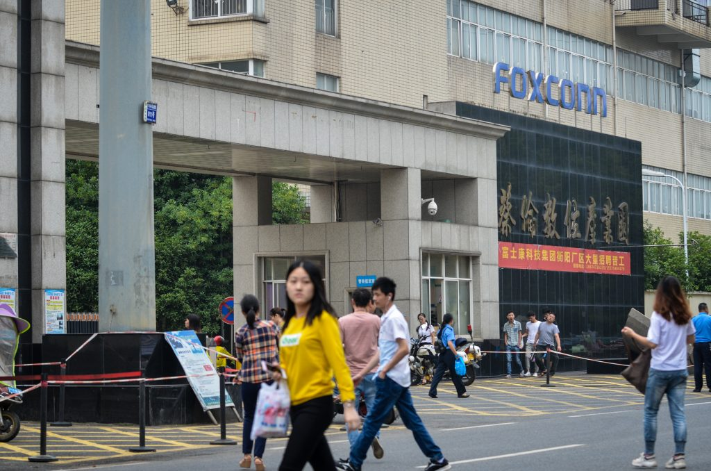 Workers arrive for the start of their shifts at the Foxconn factory in Hengyang, in Hunan Province, central China. The factory produces Amazon devices including the Echo, Echo Dot and Kindle. Photograph: Gethin Chamberlain
